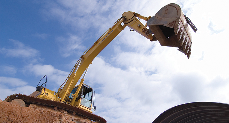 BCC Excavator Touching Sky