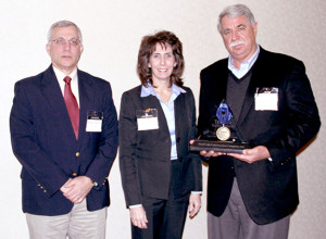 The Southern Company Triangle Safety Award was received by Brad Cole, President and Founder of Brad Cole Construction, during the annual Southern Company Safety Banquet held on February 24, 2015. From left to right: Randy Hendricks, Southern Company, General Manager of Construction; Paula M. Marino, Southern Company, Senior Vice President of Engineering & Construction Services; and Brad Cole, President of Brad Cole Construction.